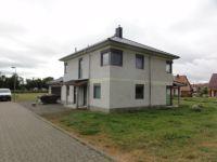 01.-Neubau-Einfamilienhaus-in-Gartenstadt-Bad-Lgs-Vorderansicht